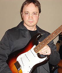 Chris Eaton with favorite guitar